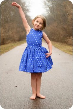 A girl wearing The Appelstroop PDF Sewing Pattern dress