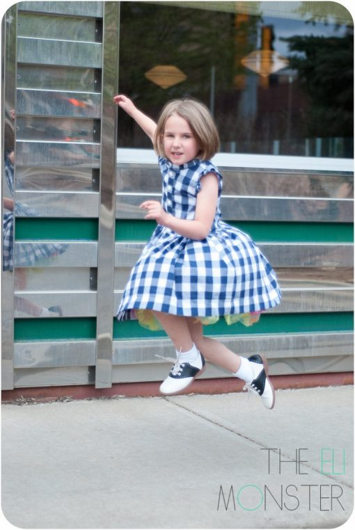 Girl jumping in retro dress