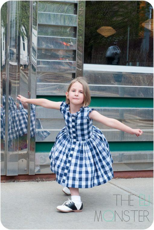 Girl curtsying in retro dress