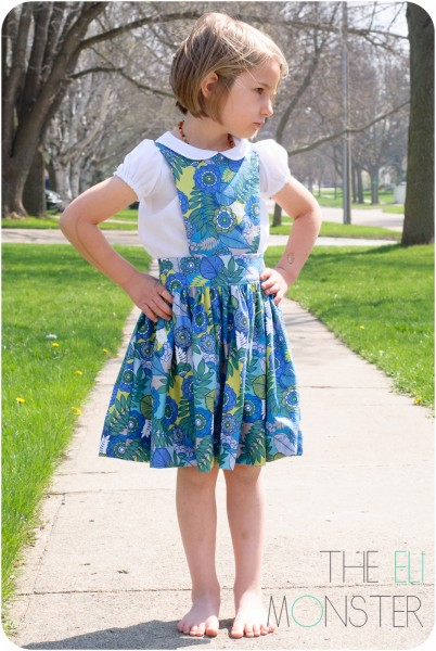 Child wearing handmade pinafore