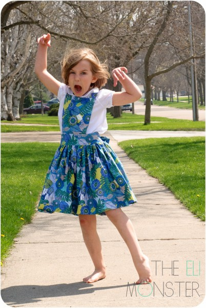child being funny in dress