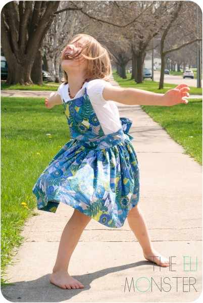 Child being silly in pinafore