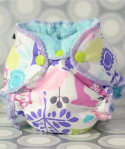 A newborn fitted cloth diaper