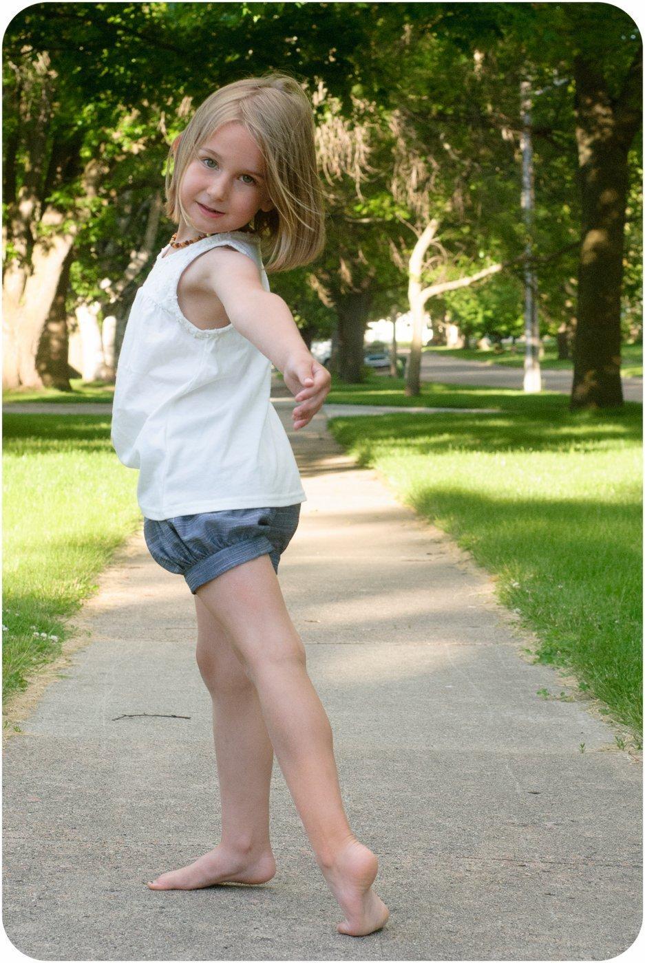 Summer Vine Preteen Girl Sitting Hand Straightens Hair