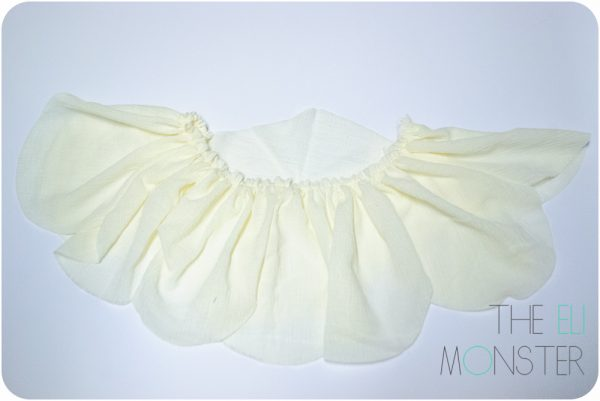 The gathered skirt from the back. The front middle petal is not gathered and has an upside down V shape at the top.