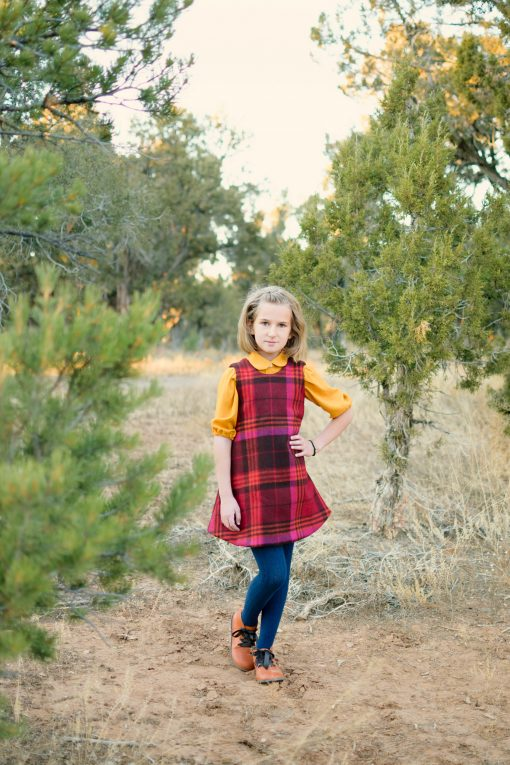 girl wearing plaid dress made from a free dress sewing pattern