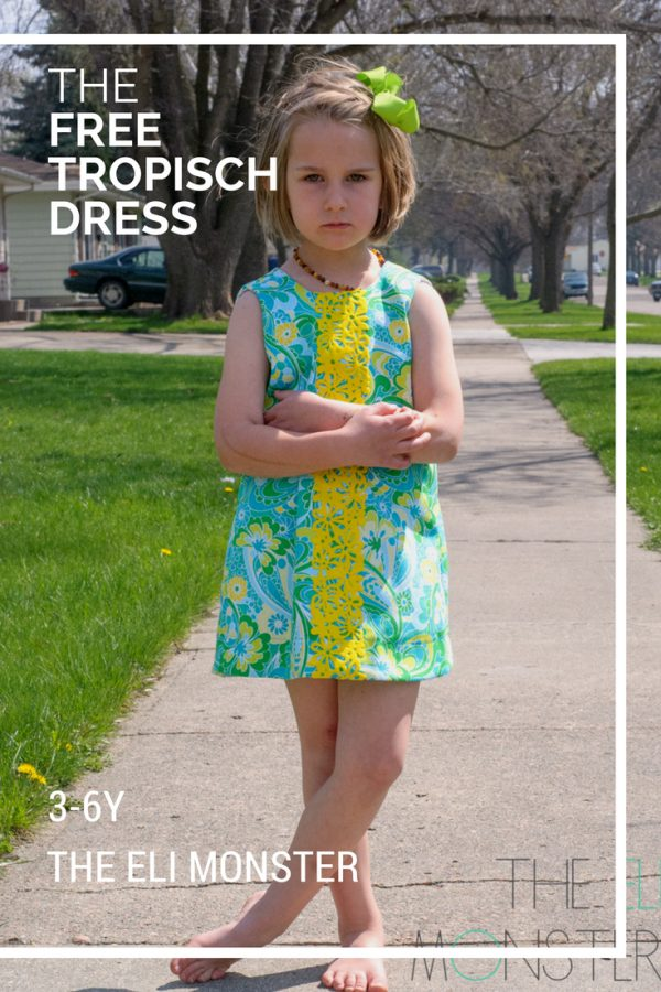 free dress sewing pattern little girl wearing a blue and green dress with a yellow floral stripe made from the