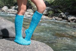 Model wearing The Skola Socks knitting pattern