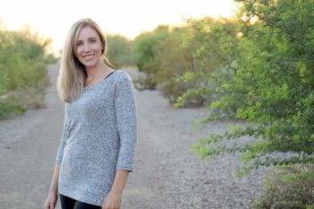 Woman wearing grey top from The Maritiem Top sewing pattern