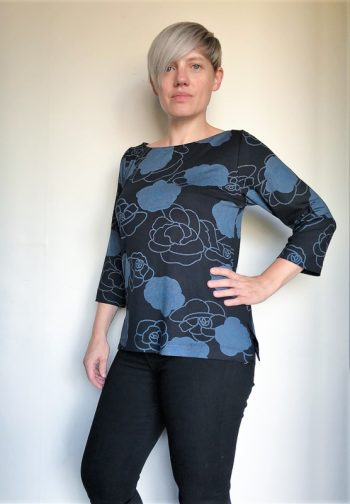 Woman wearing floral top made from The Maritiem Top Sewing pattern