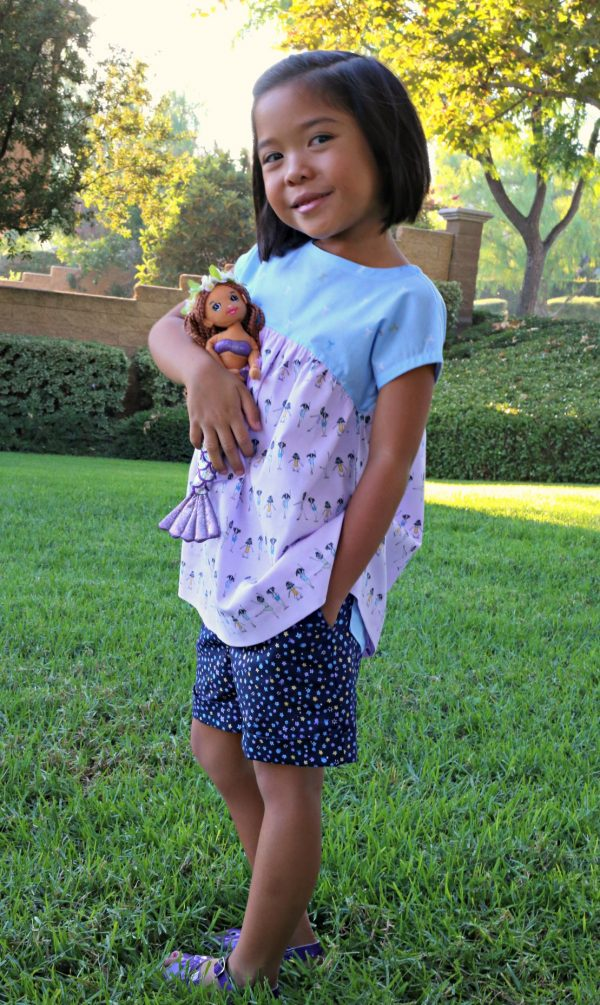 Girl wearing tunic made from a sewing pattern