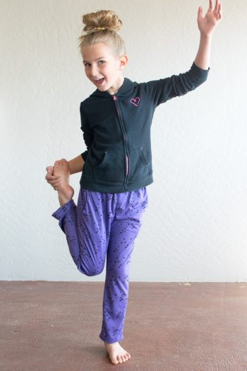 Girl wearing purple knit pants made from The Reizen Pants Sewing Pattern