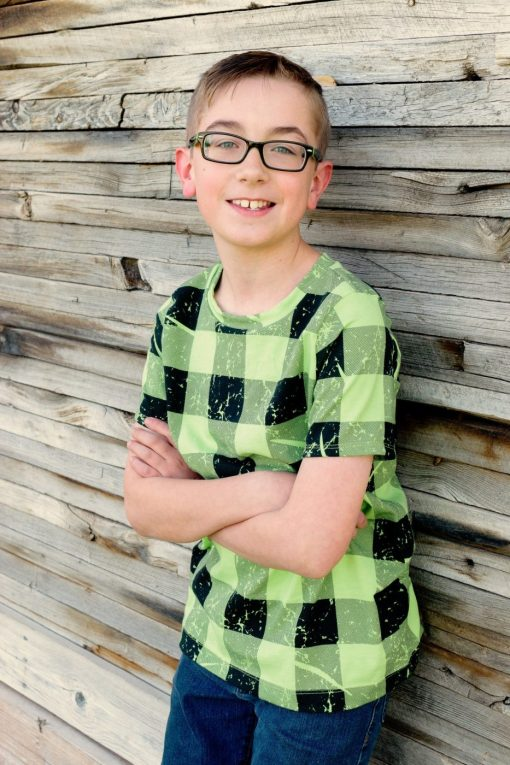 boy wearing green and black plaid tshirt made from the drop sewing pattern