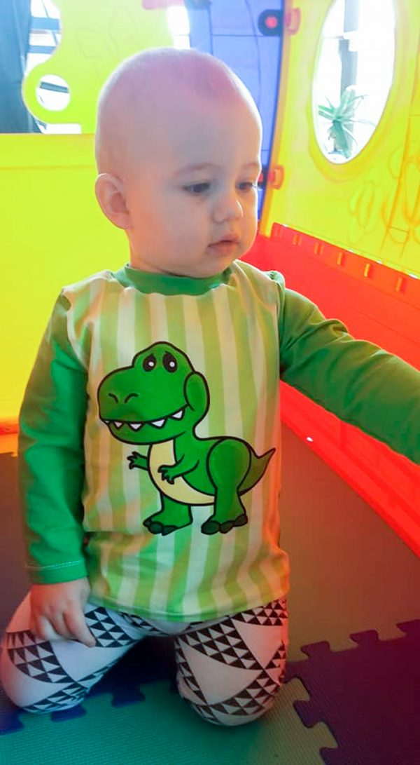 baby wearing dino tee shirt made from The drop tee sewing pattern