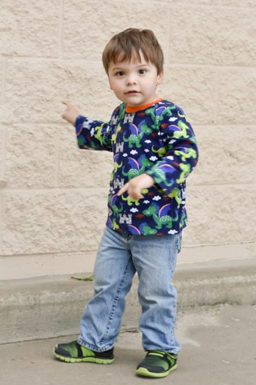 A boy wearing blue long sleeve tshirt made from the drop tee sewing pattern