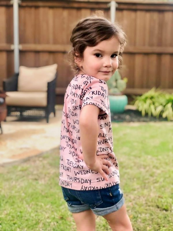 Girl wearing pink tee made from The Zoet Tee sewing pattern