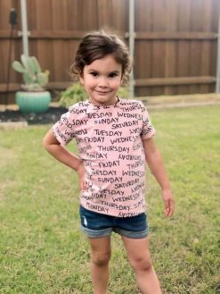 Girl wearing pink tshirt made from The Zoet Tee sewing pattern