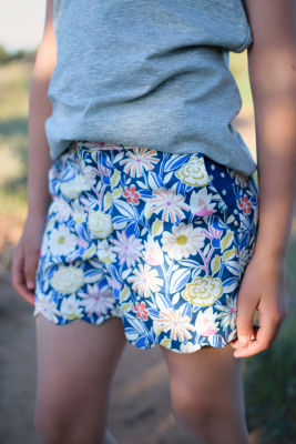 Girl in desert wearing an upcycling challenge gray tank and floral scallop hem shorts.