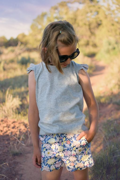 Girl in desert wearing an upcycled gray tank and floral scalloped shorts.