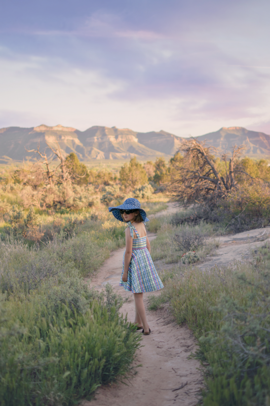 Girl in desert wearing plaid sun dress made for an upcycling challenge.
