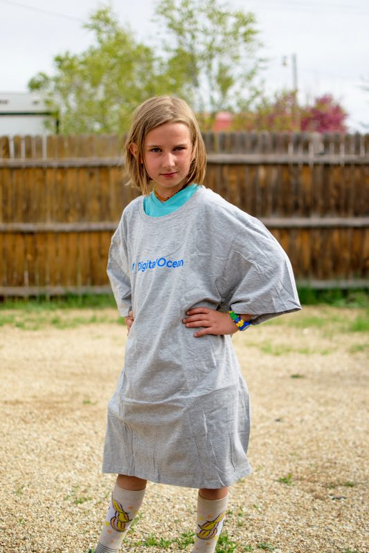 Girl wearing oversized tshirt that will be used in an upcycling challenge