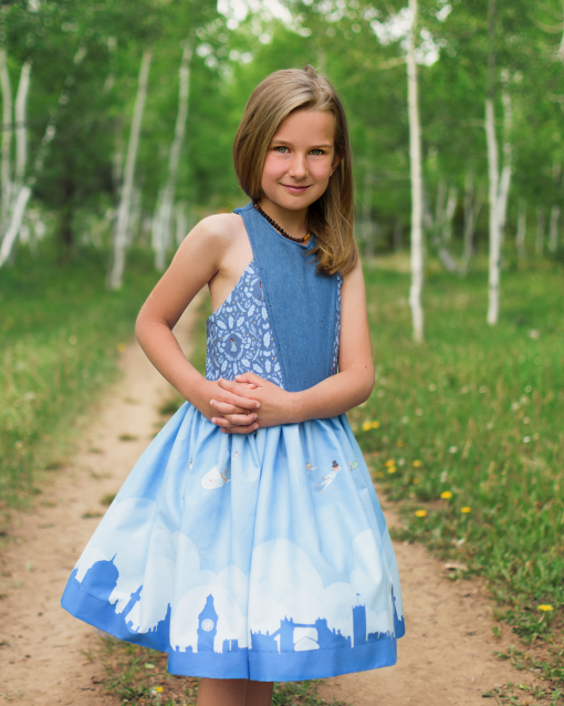 Girl wearing a blue dress from the aardbei dress sewing pattern