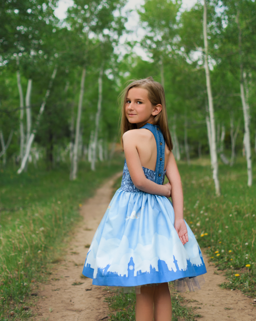 Girl wearing a blue dress from the aardbei sundress sewing pattern
