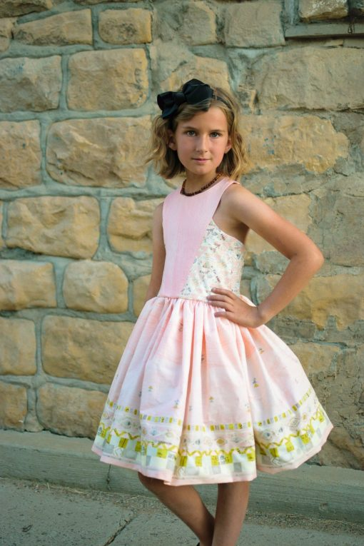 Girl wearing a pink dress from the aardbei sundress sewing pattern
