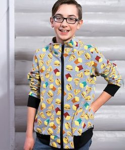 Boy wearing track jacket with hamburgers and pizza on it standing in front of gray log wall.