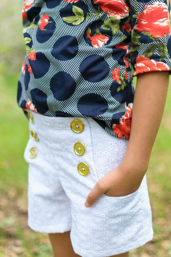 Closeup of white eyelet sailor shorts made from the oceaan shorts sewing pattern
