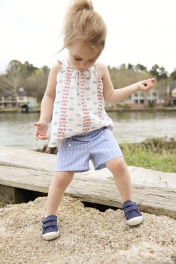 girl wearing blue shorts made from the oceaan shorts sewing pattern.