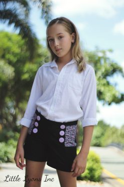 girl wearing black shorts made from the oceaan shorts sewing pattern.