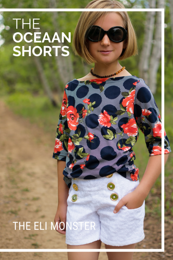 Cover for the oceaan shorts sewing pattern. Girl wearing floral boatneck tee with white eyelet sailor shorts.