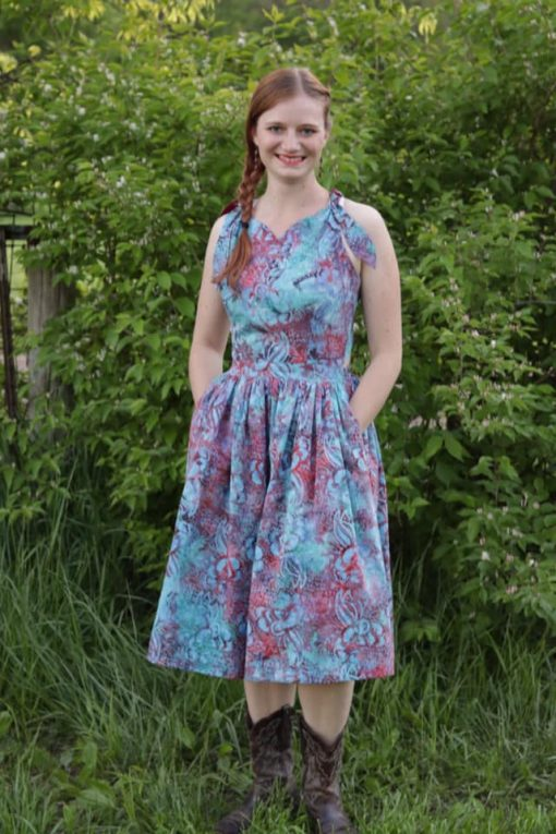 Young woman wearing purple and blue dress made from the Mooi Sundress sewing pattern