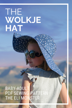 cover image for The wolkje hat sewing pattern featuring girl wearing blue polka dot hat