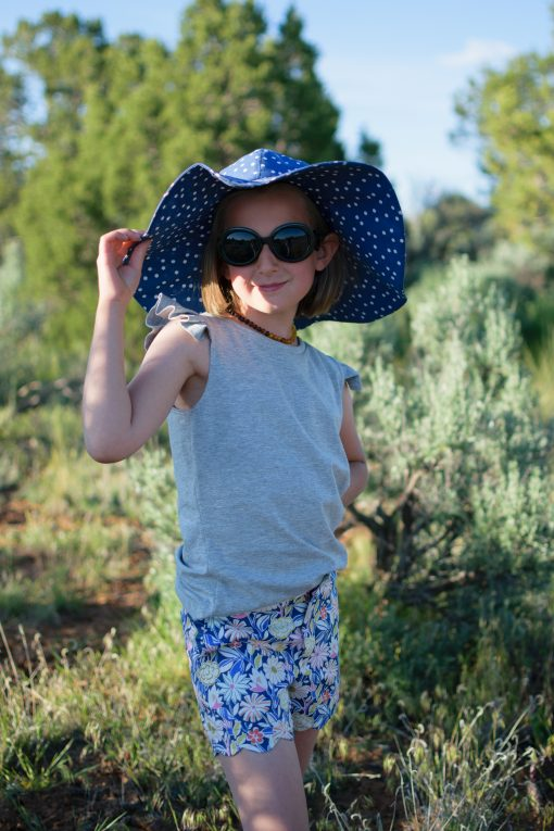 Girl wearing sunhat made from the Wolkje Hat sewing pattern.