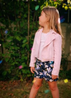 girl in pink jacket and floral shorts made from the blij shorts sewing pattern