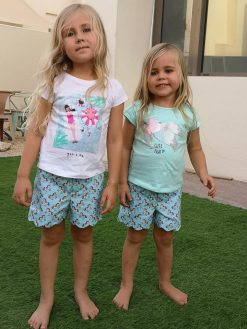 two girls wearing blue shorts made from the blij shorts sewing pattern