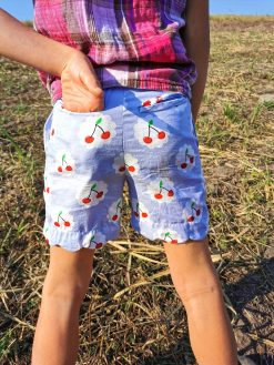 The back of cherry shorts with a hand in the pocket made from The Blij Shorts Sewing Pattern