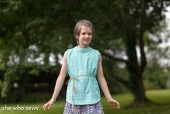 Girl wearing a top made from the portret top blouse sewing pattern without the bow.