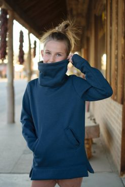 Girl wearing navy sweatshirt made from The Asteroide Shirt Sewing Pattern