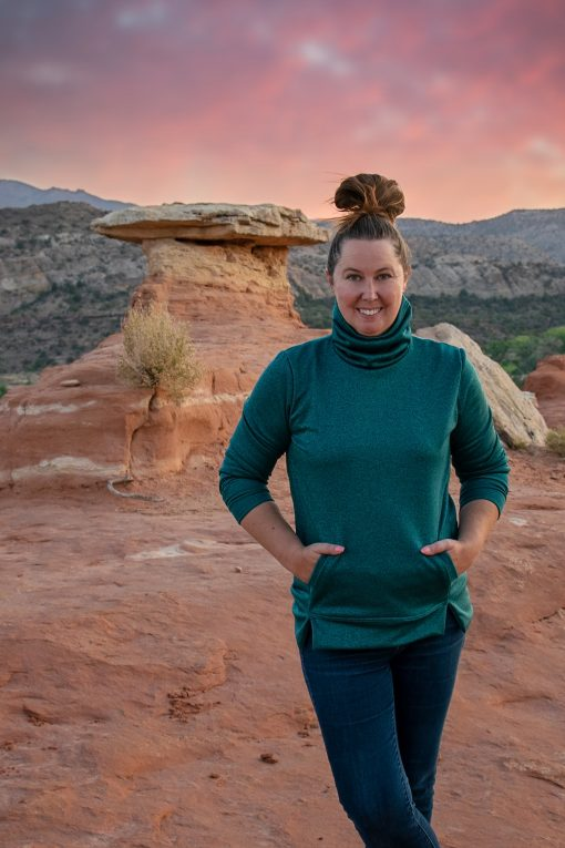 Woman wearing turquoise shirt made from the asteroide sweatshirt sewing pattern