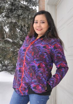 Woman wearing a purple swirl bomber jacket made from the hagelslag jacket sewing pattern