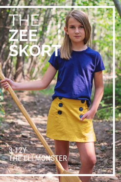 Girl in woods holding an oar wearing mustard yellow navy skort made from the zee skort sewing pattern