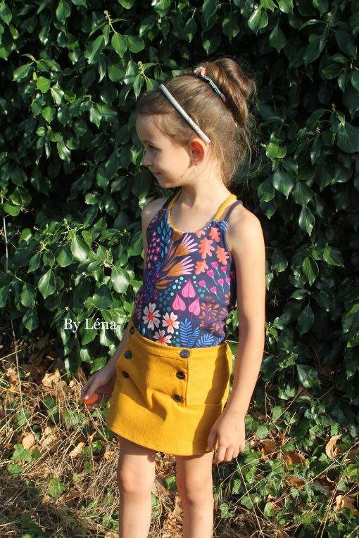 Girl wearing mustard yellow skort made from The Zee Skort Sewing Pattern