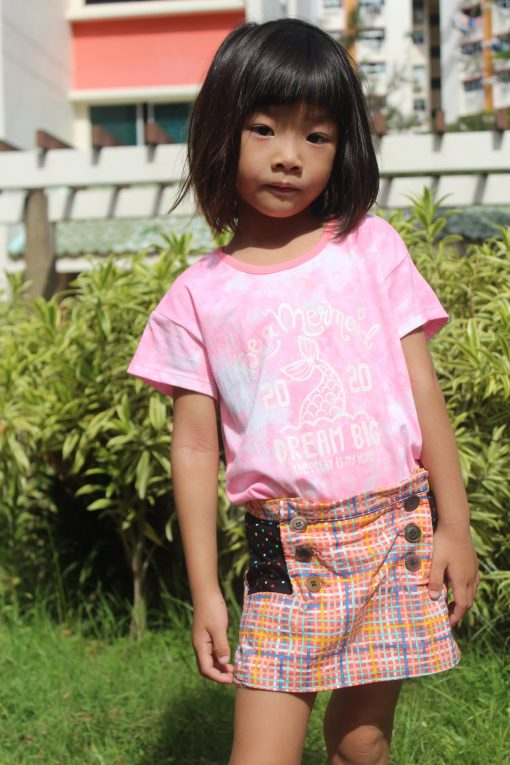 Girl wearing plaid skort made from The Zee Skort Sewing Pattern