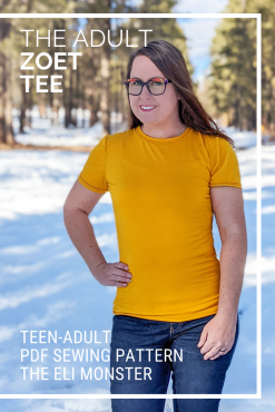 Woman standing in the snow wearing a mustard gold tshirt made from the zoet tee sewing pattern